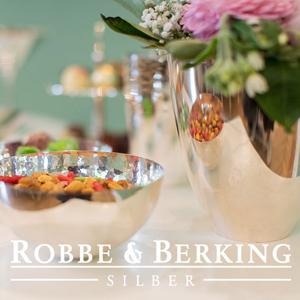 Foto mit Silberschale und Logo Robbe und Berking